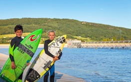 Surfers with surf boards at Surf Snowdonia